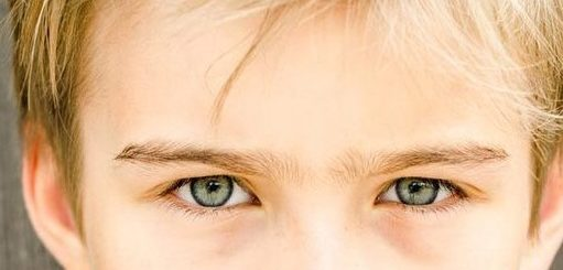 Blond boy with azur eyes